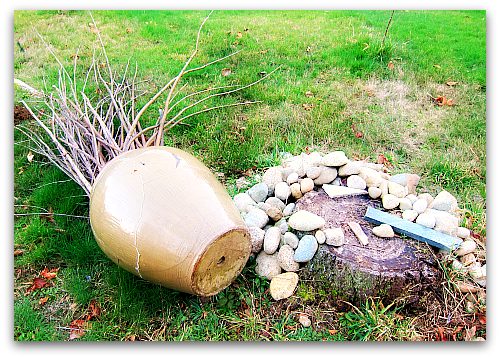 windblown pot tipped over  Sticks and Stones Have Found a Home
