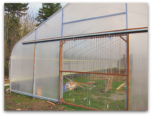 barn door hoophouse  When a Greenhorn Builds a Greenhouse